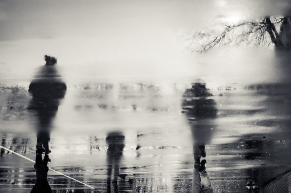 Reflections of people in the rain