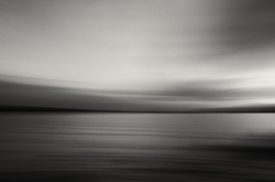 A sunset over the ocean, panned in black & white