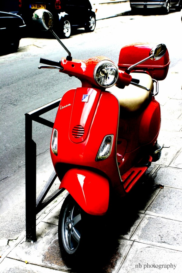 red scooter vespa paris rue de lille 75007 france