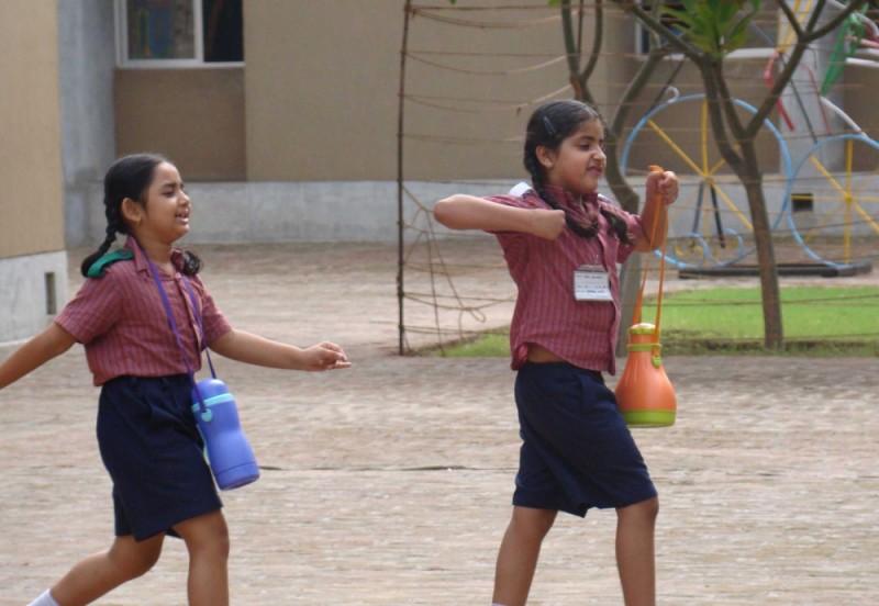 children walking in a file