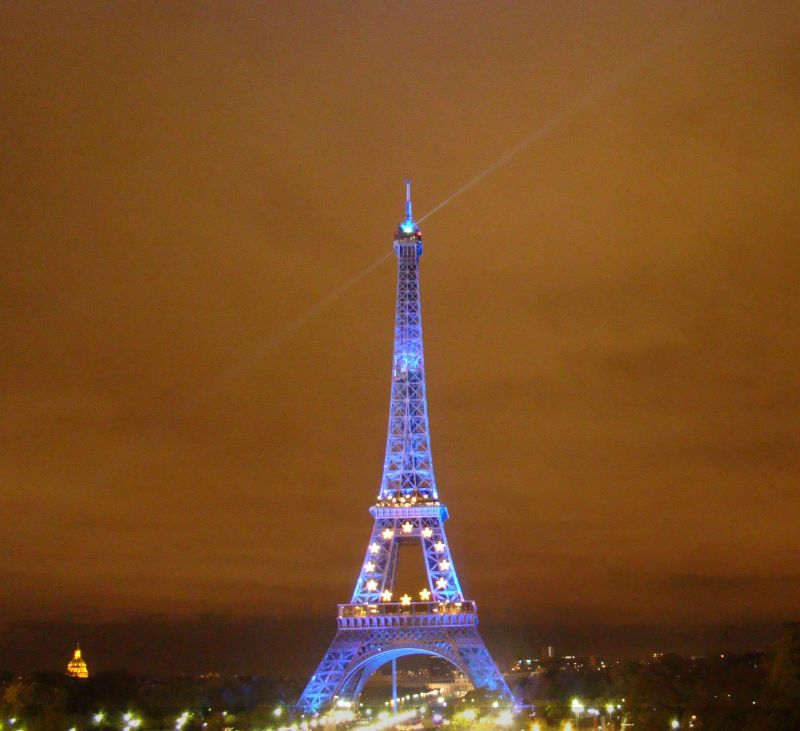 Eiffel tower bathed in blue light
