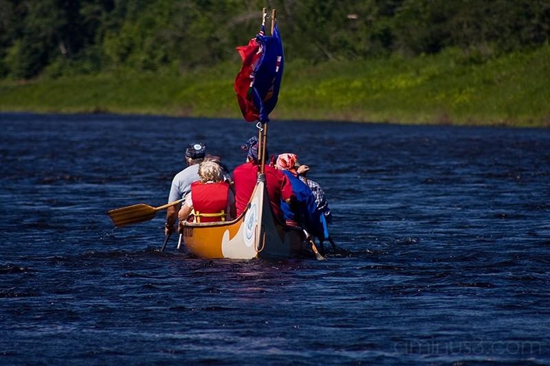 voyageurs in canoe on the rifver