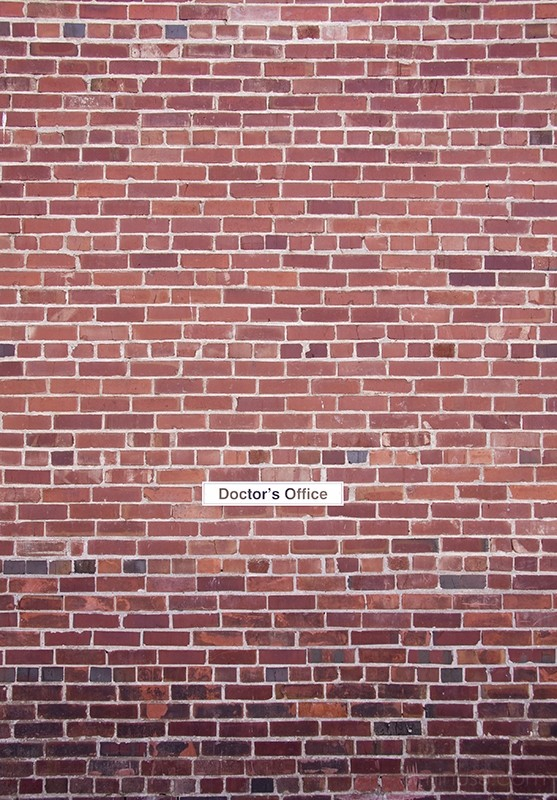 brick wall with sign