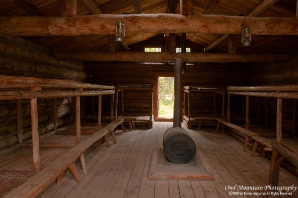 first settlers sleeping log cabin