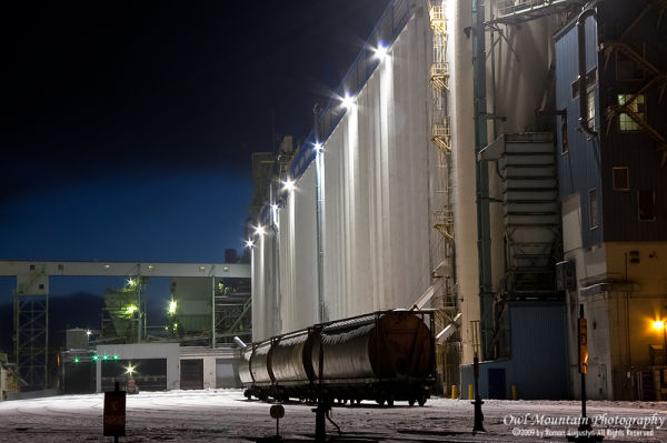 night view of grain elevators in winter