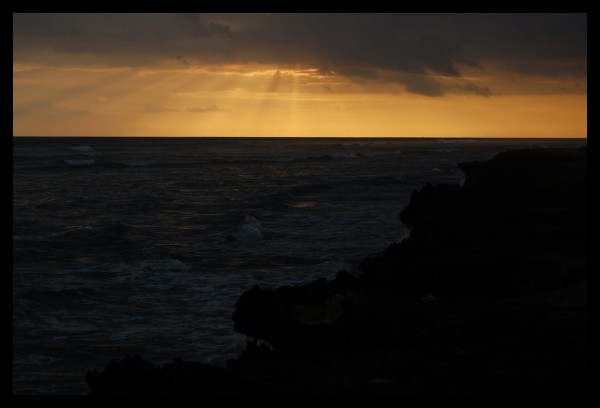 crepscular rays at sunset in hawaii
