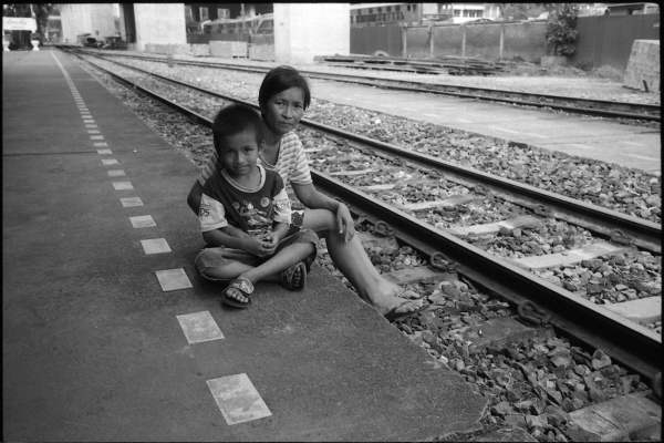 waiting for the train to sell bananas