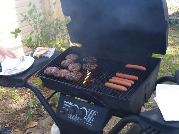 Hamburgers and hotdogs being grilled