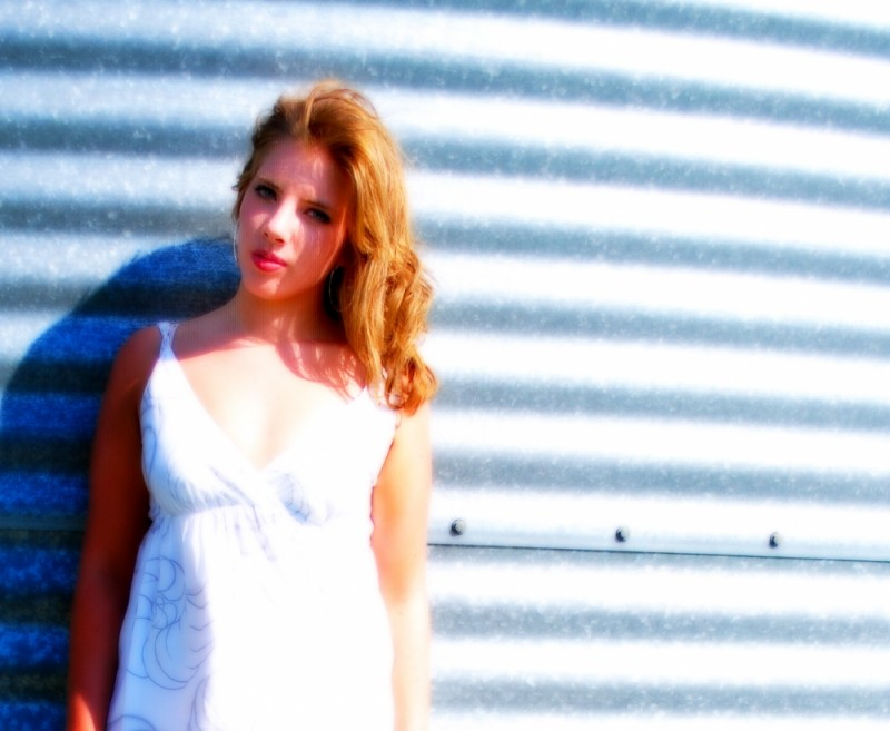 Leigh posing against a grain tower