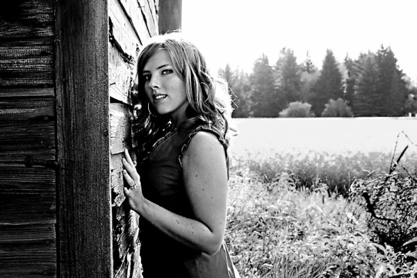 Leigh modeling at a old shack in a canola field