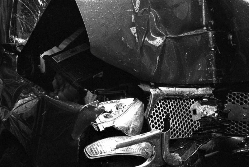 wrecked car on a new york city street