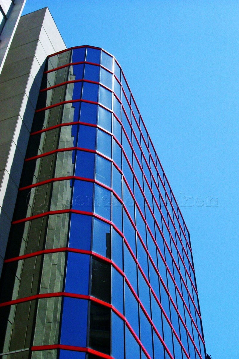 blue and red office tower on eglinton, toronto