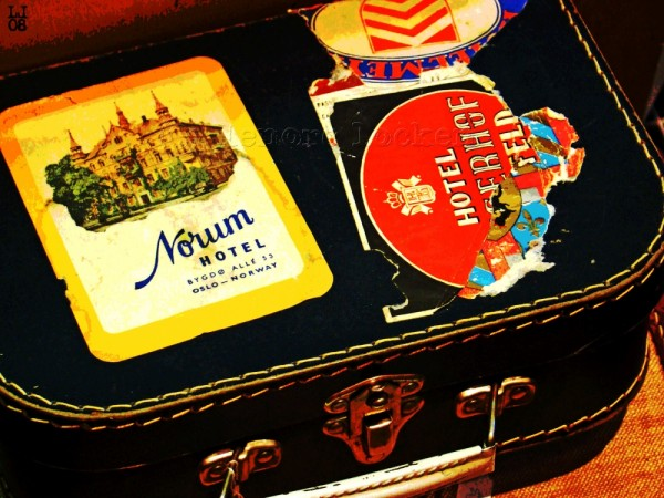 suitcase covered in travel stickers