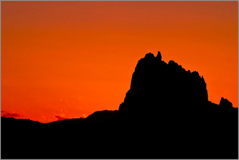 Silhouette of Shiprock at sunset.