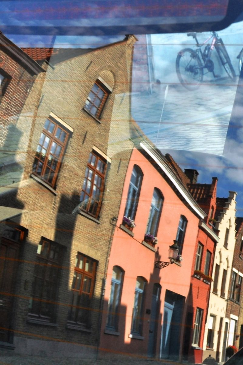 bicycle houses reflection bruges belgium