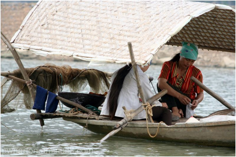 Women on river - Vietnam