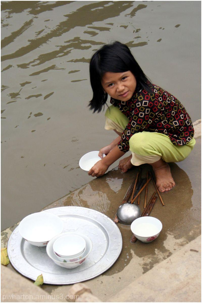 Washing dishes in the river - Keng Ga, Vietnam