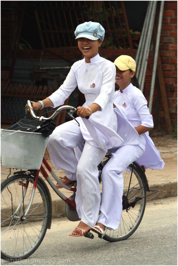 Young women riding bicycle - Vietnam