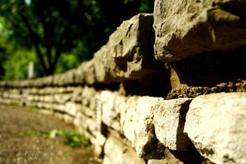 Bordering Brick Wall