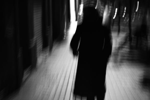 night city street people shadows movement lights