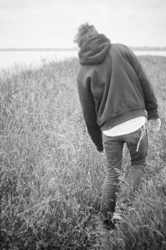 Conceptual black and white portrait of a boy.