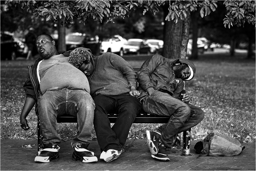 Three men on a bench in Capital Hill Washington DC