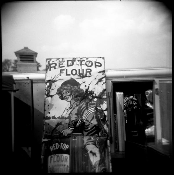 sign at sparks, ks flea market - b&w holga photo