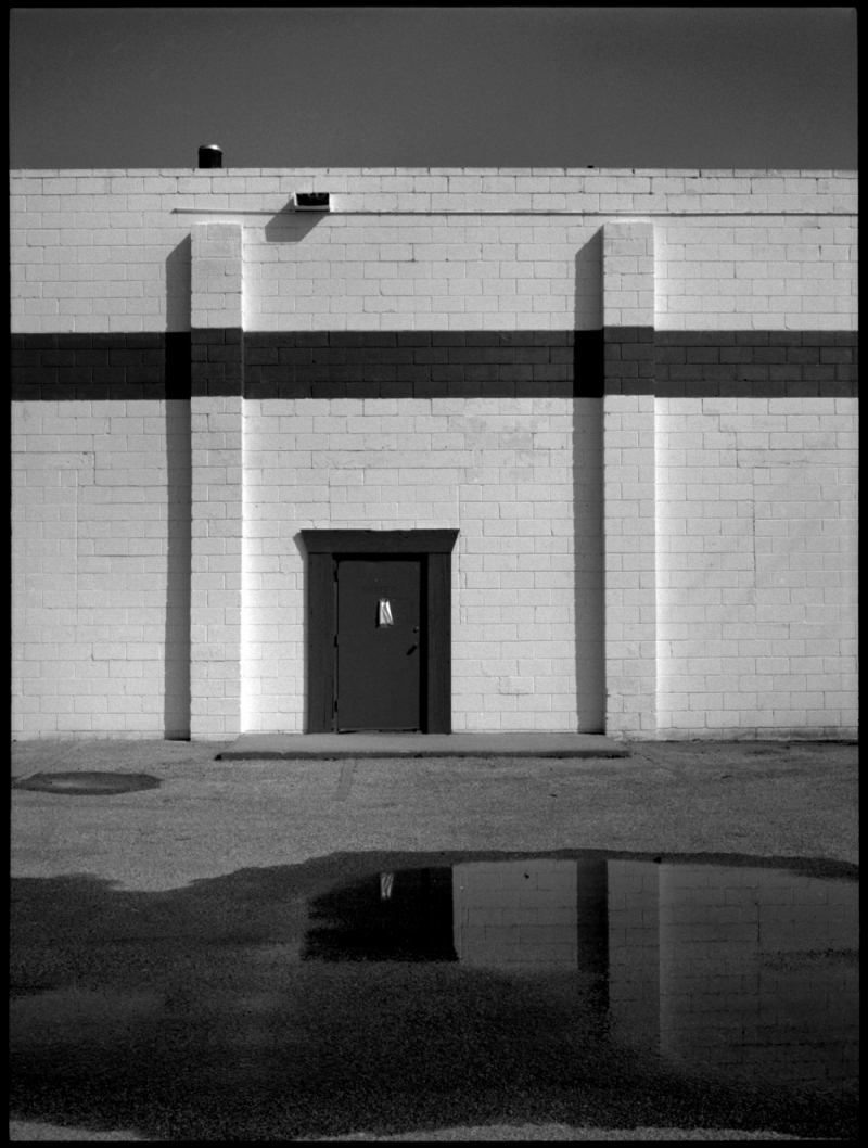 warehouse reflection in puddle - fuji gs645 b&w