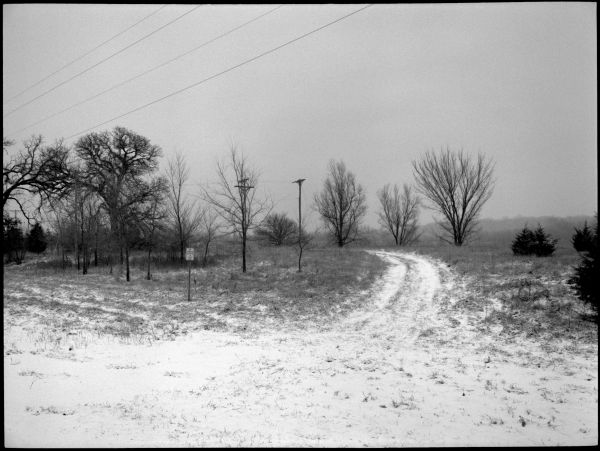 snowy rural road - b&w photo