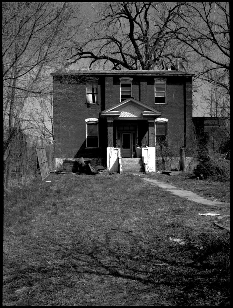 abandoned parish house - b&w photo
