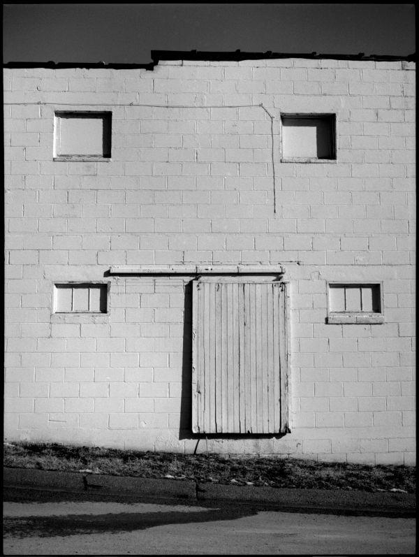 cinder block building - claycomo, mo - b&w photo