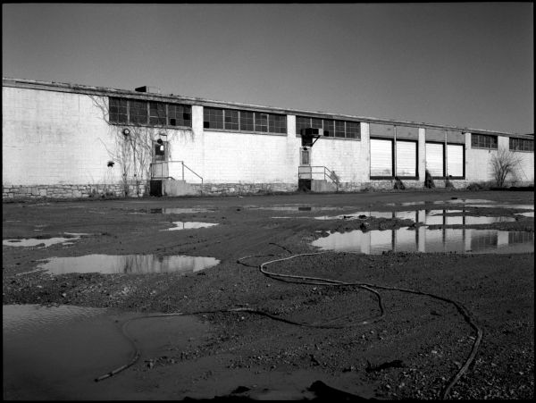 industrial reflections in puddles - b&w photo