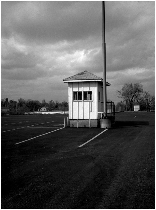 masonice lodge parking hut - b&w photo