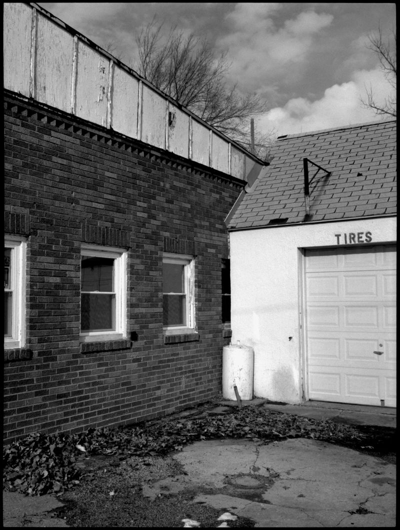 auto repair shop in winter - b&w photo