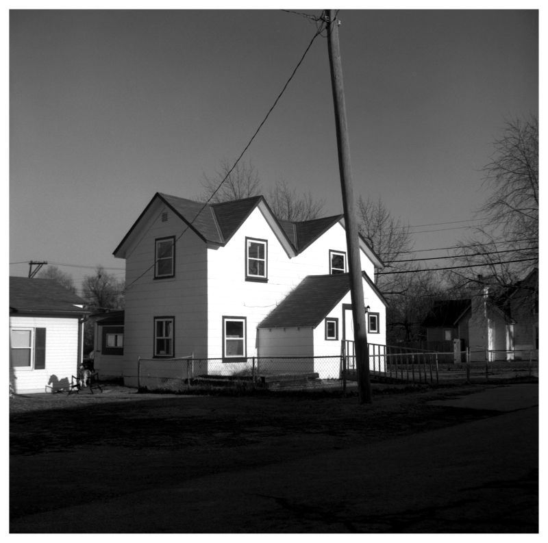white house, small town - b&w photo
