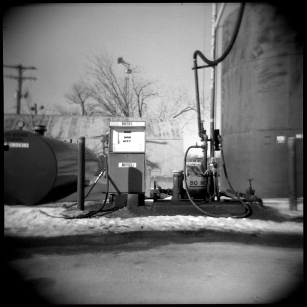 holga photo, black & white, diesel fuel in snow