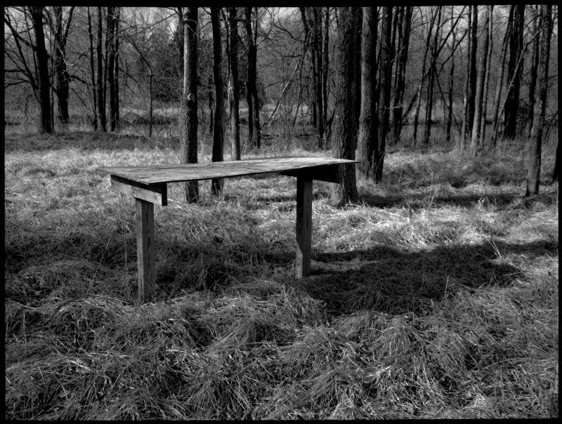 photograph, b&w, rural scene with table