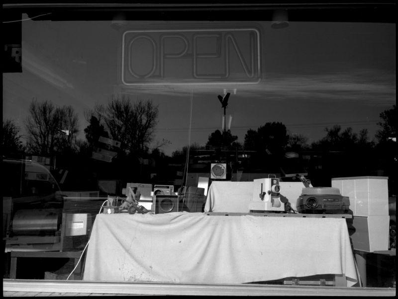 photograph, b&w, window display, camera store