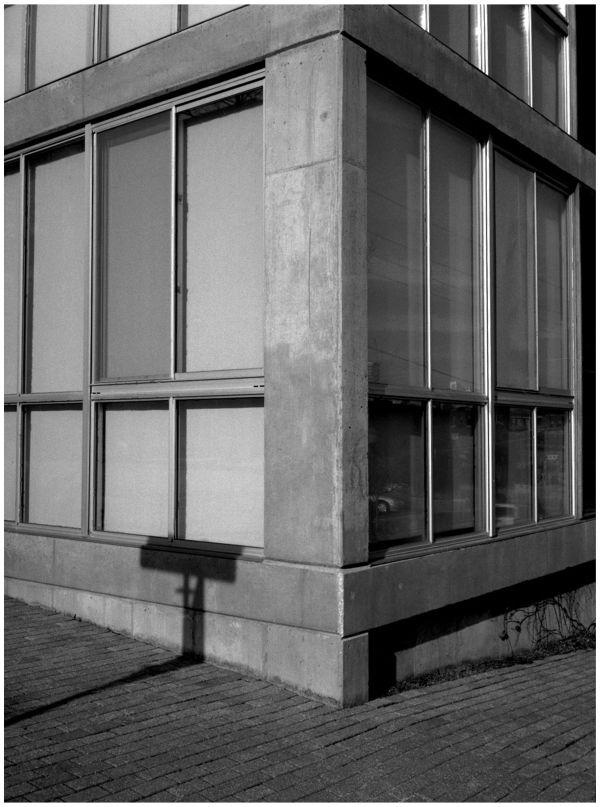 b&w photograph, city scene, street corner