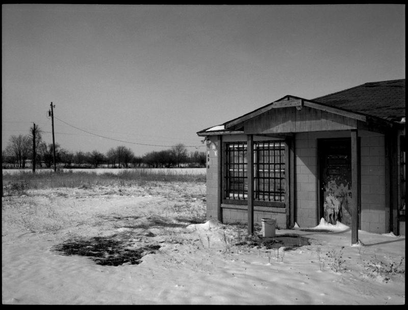 abandoned house, rural snow scene, b&w photo
