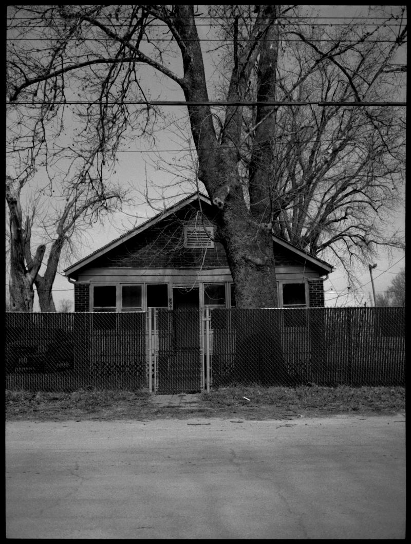 small house behind a fence, missouri, photograph