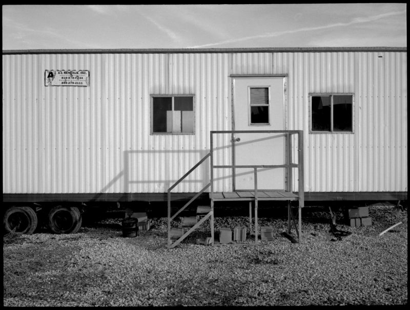 construction trailer, photograph, b&w