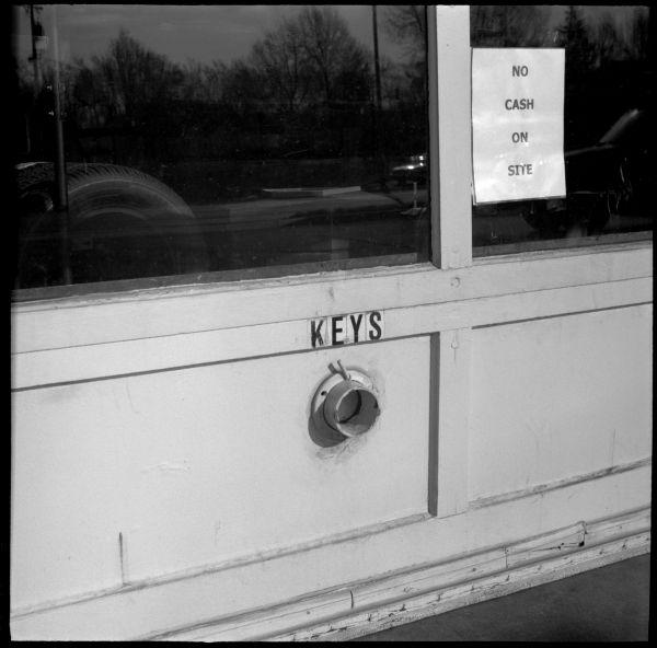 gas station key drop, warning sign, photograph