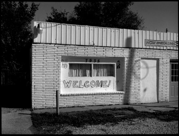 welcome sign - daycare building in kcmo