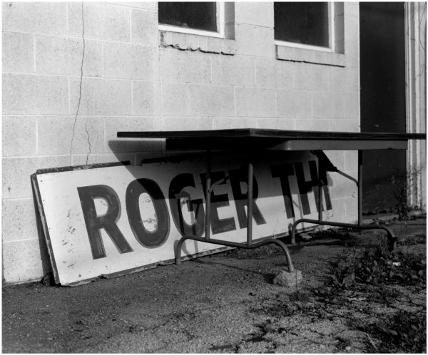 roger the plumber - old sign - photo - b&w