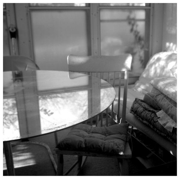 interior photo - sun porch and glass table