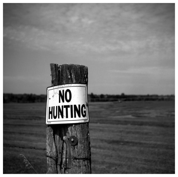 no hunting sign on a farm fence post in kansas