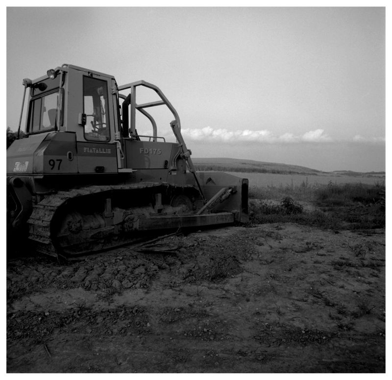 bulldozer at the end of a dirt road - kansas