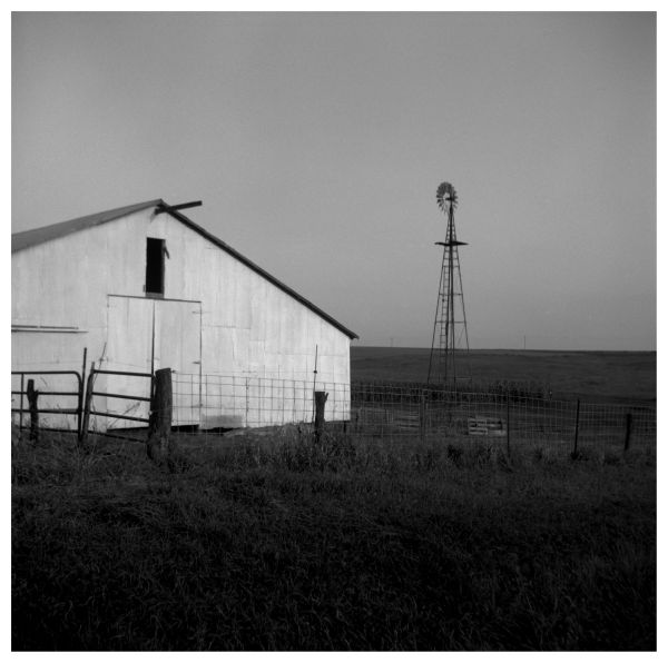 barn, fence, and windmill - farm in highland, ks