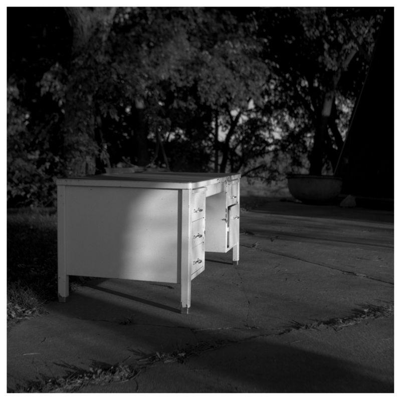 white desk left on a driveway - atchison, ks